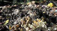 Plastic bottles burning toxic pollution Stock Footage