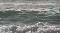 Close-up of waves rolling in gently in the last afternoon.  This was shot on a - stock footage