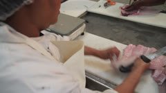 Fish Factory cutting and weighing pieces Stock Footage