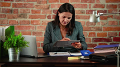 Woman using tablet in the office Stock Footage