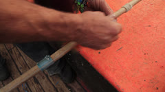 Fisherman preparing Tuna Pole Line Fishing Rod Stock Footage