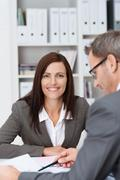 Smiling businesswoman in a meeting Stock Photos