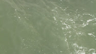 Stock Video Footage of Shot from above of green churning ocean water.