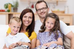 Happy family with a small son and daughter Stock Photos