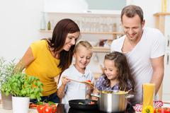 young family cooking in the kitchen - stock photo