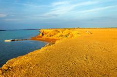 barren desert and ocean - stock photo