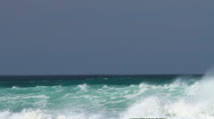 Aquamarine blue waves rolling in to shore with wind blowing white caps - stock footage