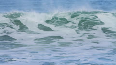Wide vista of waves rolling in; wind blowing and white caps. Stock Footage