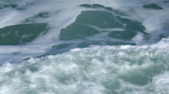 Ocean surface slowly rolling with white caps - stock footage