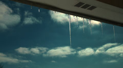 Icicles with clouds Stock Footage