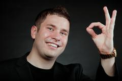 Young man gesturing the ok okay hand sign Stock Photos