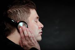 Young man with headphones listening to music Stock Photos