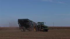 Tractor pulls peanut trailer Stock Footage