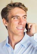 young professional, handsome man using smart mobile phone - stock photo