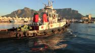 Stock Video Footage of Iconic shot of Tug Boat in Cape Town Harbour