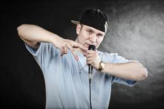 Rap singer man with microphone cool hand gesture Stock Photos