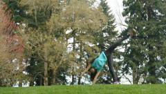 Girl Doing Cartwheels In The Park Stock Footage