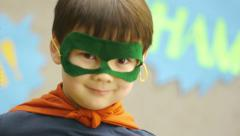 Superhero Boy Smiles For The Camera, Disappears Stock Footage