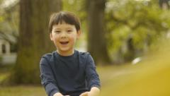Cute Little Boy Rides Seesaw - stock footage