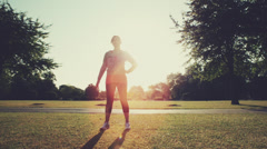 Woman exercising outdoors in park morning Stock Footage