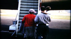 Passengers board airplane, taxi and take off, 246 vintage film home movie Stock Footage
