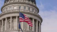 Stock Video Footage of Capitol Building American Flag changing directions