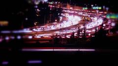 Brilliant blue traffic, freeway, tilt shift light leaks, lens flare, night - stock footage