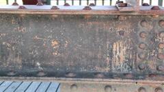 Steel beam on wooden bridge rusty rectangular metal Stock Footage