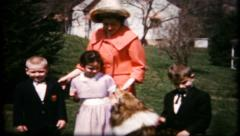 Mom, kids and the dog pose for photo in backyard, 223 vintage film home movie Stock Footage