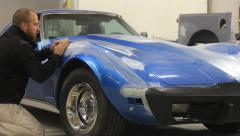 AUto body collision and restoration work on a an Stingray Corvette - stock footage