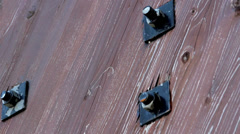 Bolts in the wood set of nuts and bolts Stock Footage