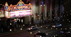 El Capitan Disney Theatre Walk of Fame Hollywood Boulevard Car Traffic Night Lit Stock Footage