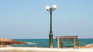 Stock Video Footage of The oldest lamp and bench by the seaside