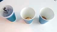Three blue empty plastic coffee cups and a black straw Stock Footage
