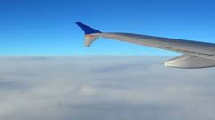 Flying over clouds - deep blue sky above Stock Footage