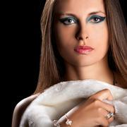 beautiful woman in fur on black background - stock photo