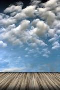 Old wood floor and cloudy sky Stock Photos