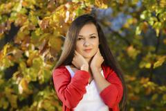 young woman in a romantic autumn scenery - stock photo