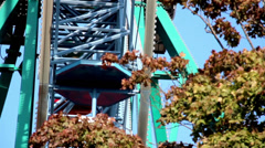 martian themed ferris wheel moving blue sky - stock footage