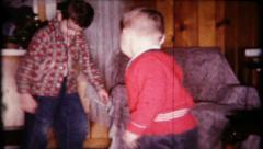 217 - brothers try to dance for mom and dad at home - vintage film home movie Stock Footage