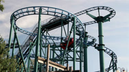Red roller coaster running in its tracks Stock Footage