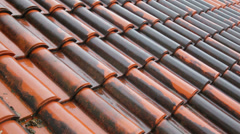 Red-tiled roof in the rain, summer day Stock Footage