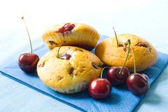 Cherry muffins Stock Photos