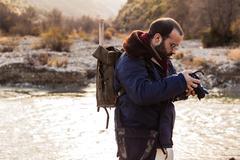 hiking photographer - stock photo