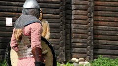 421 guy wearing a medieval costume preparing a stance as if to fight - stock footage