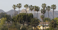 Ultra HD 4K UHD Hollywood Sign and Tower Los Angeles Hills Valley Palm Trees Stock Footage