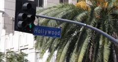 Ultra HD 4K UHD Palm Trees Car Traffic Light Los Angeles Hollywood Street Sign - stock footage