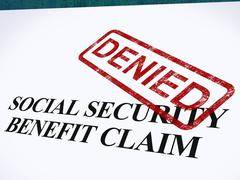 Stock Illustration of social security claim denied stamp shows social unemployment benefit refused