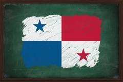 panama flag painted with chalk on blackboard - stock photo