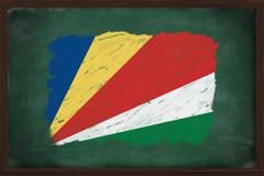 seychelles flag painted with chalk on blackboard - stock photo